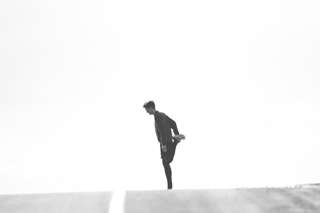 Man stretching leg