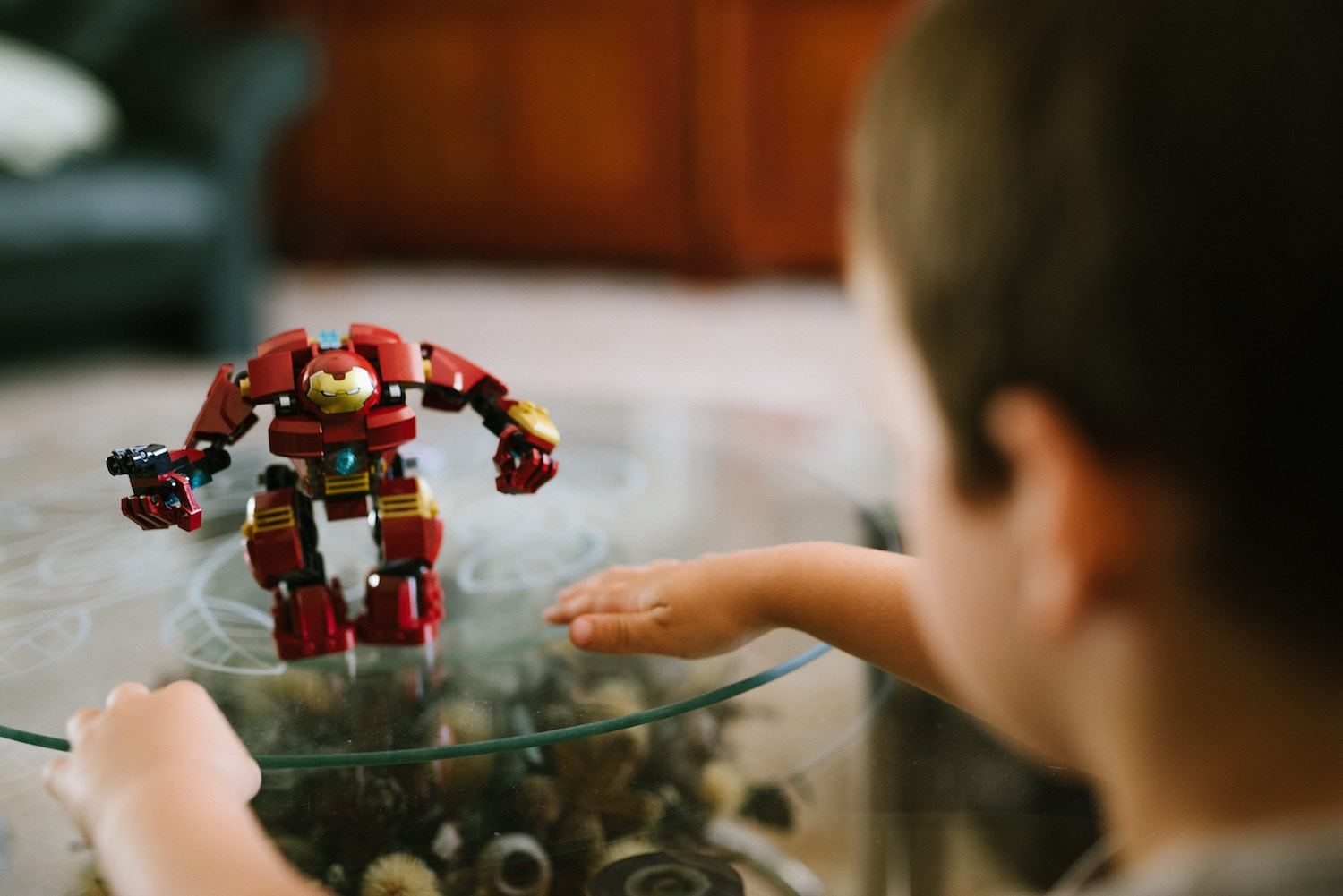 An Iron Man toy sits on a table