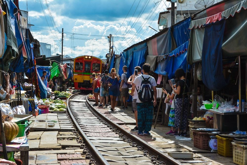 A market along a train track in Thailand