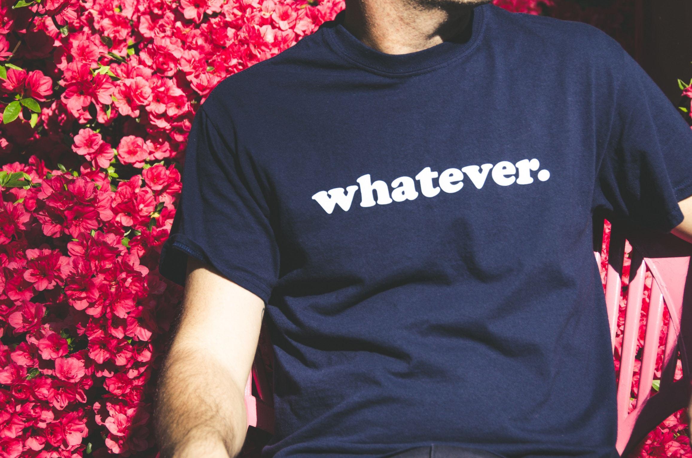 Man wearing tshirt that reads