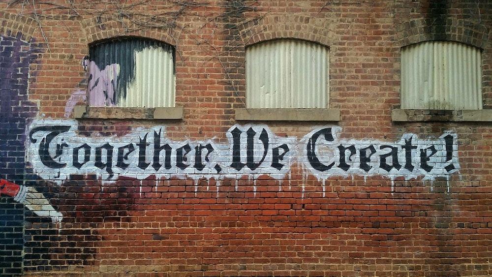 Street art on wall says