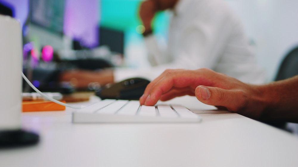 A closeup of a hand on a keyboard