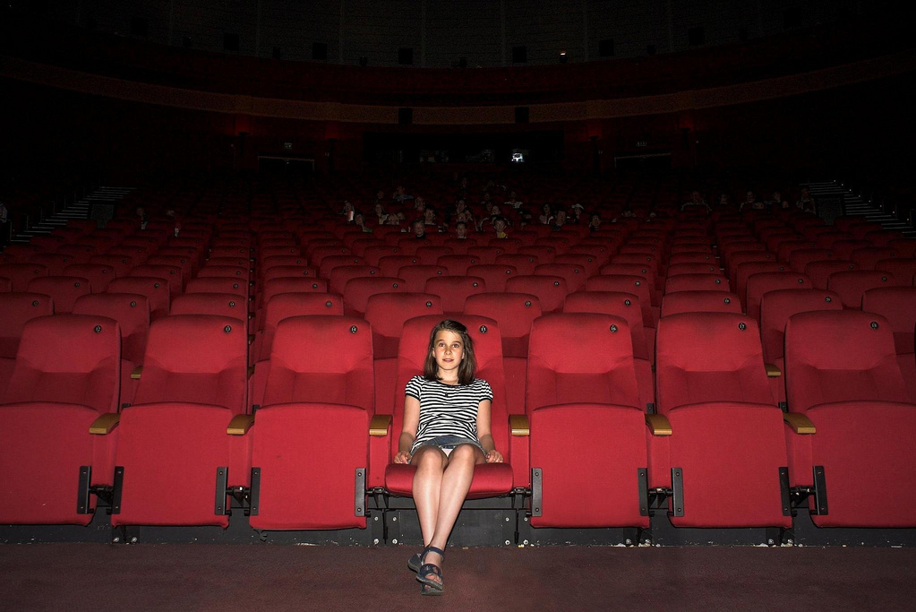 Girl in movie theater