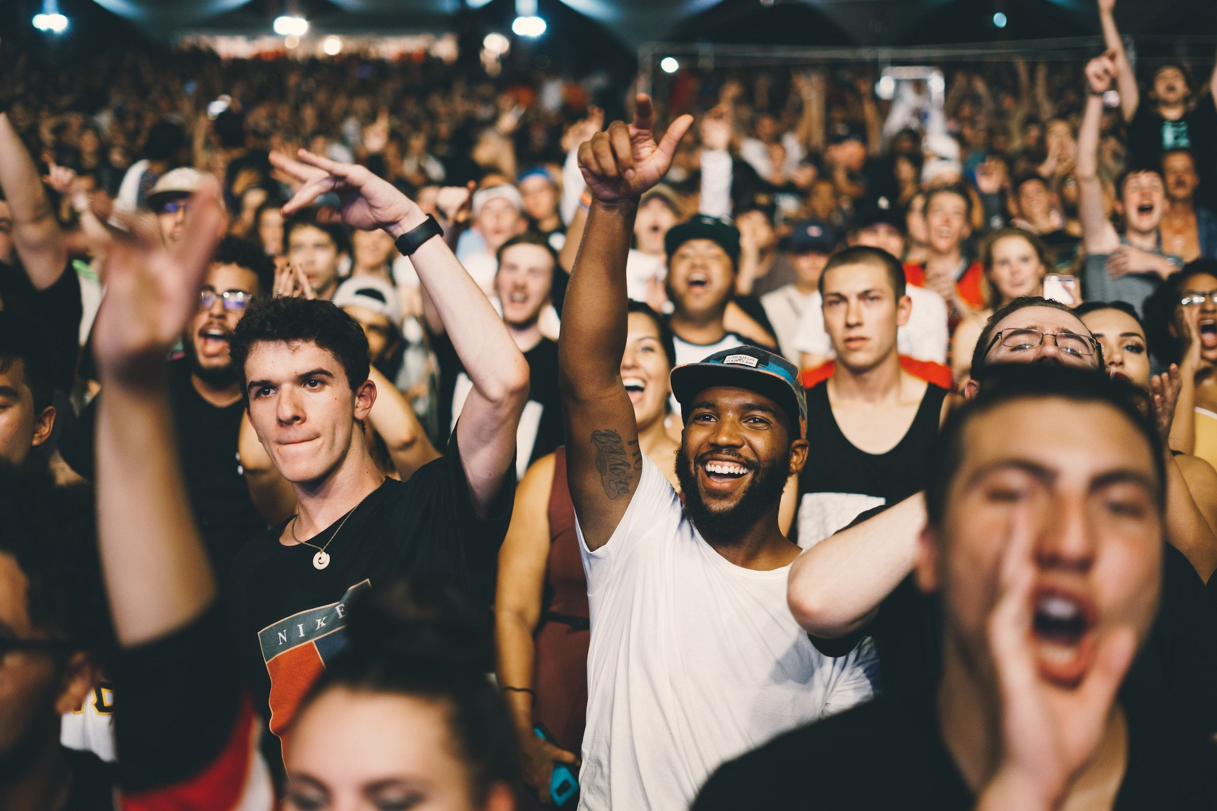 Crowd at an event, cheering