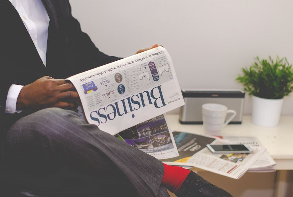 Man reading business section of newspaper