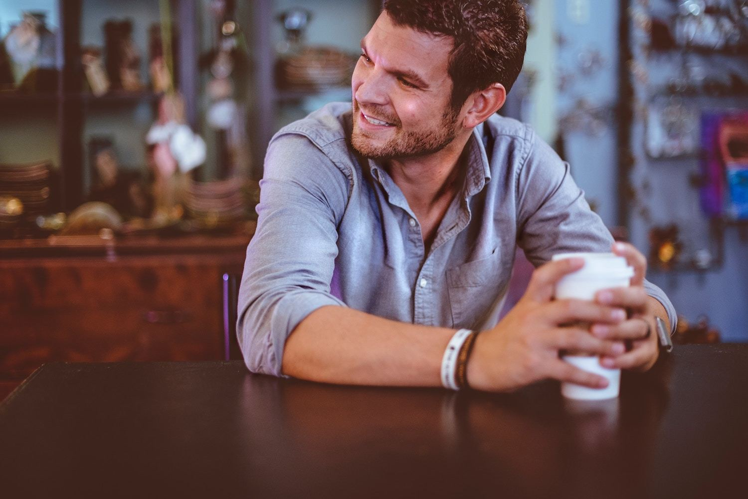Smiling man with coffee cup