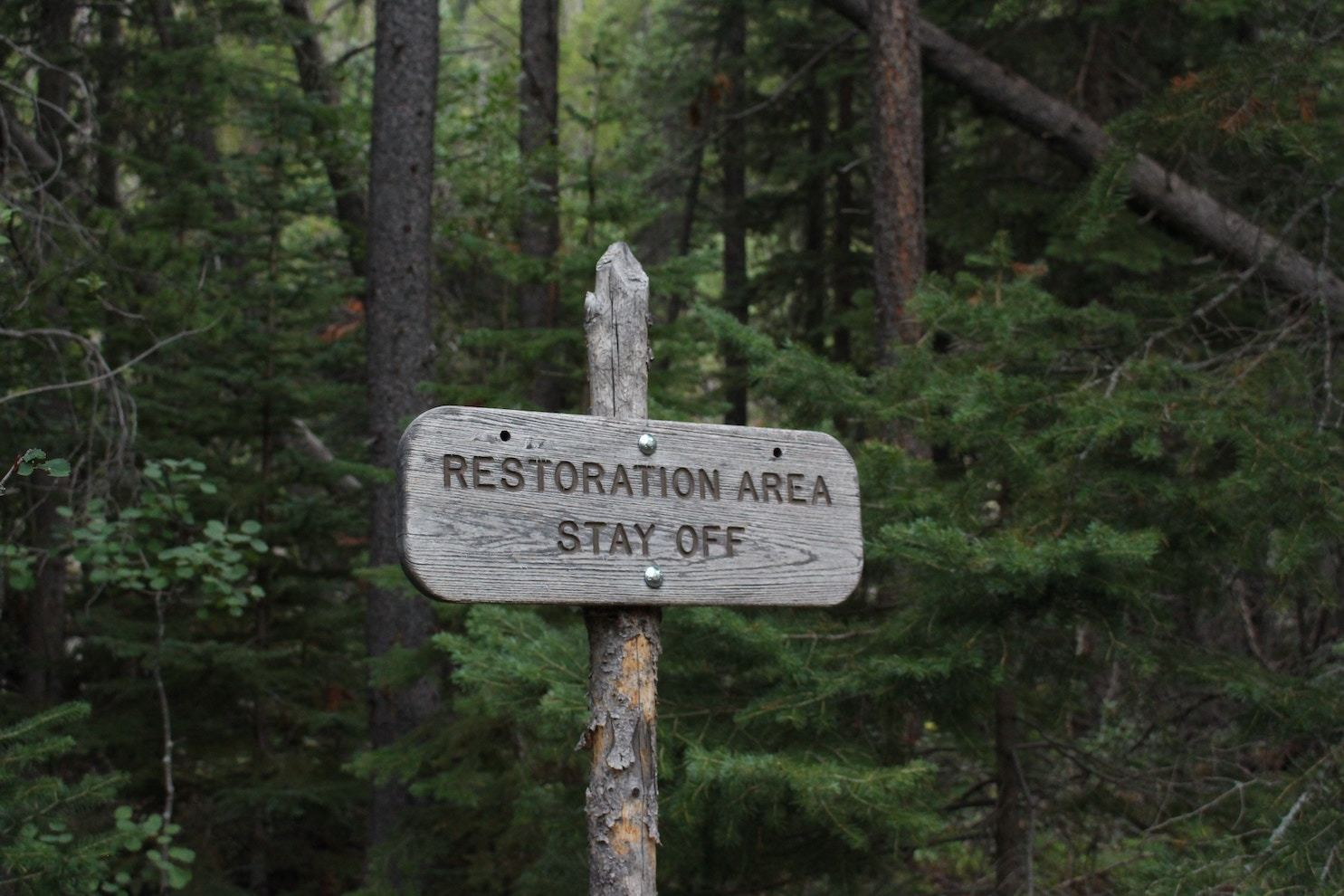 Sign in a wooded area reading