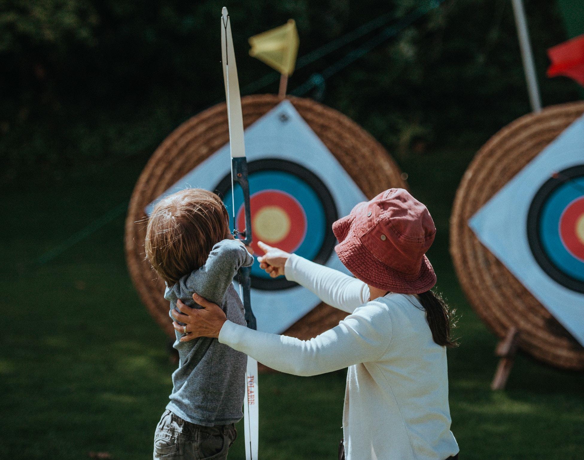 Boy learning archery
