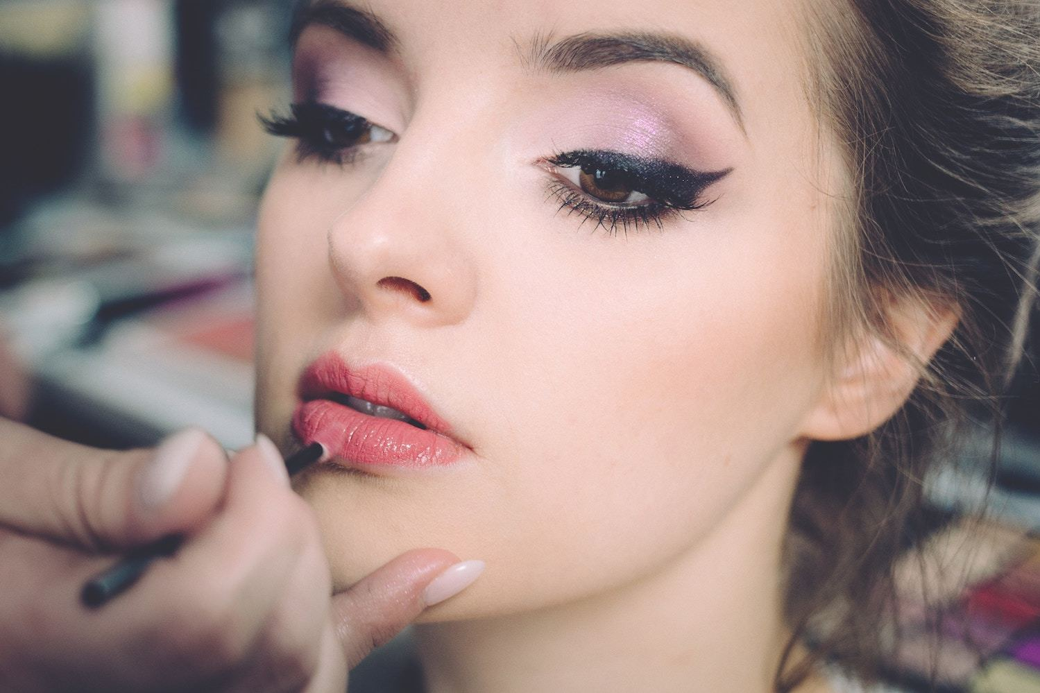 a woman having her makeup professionally done