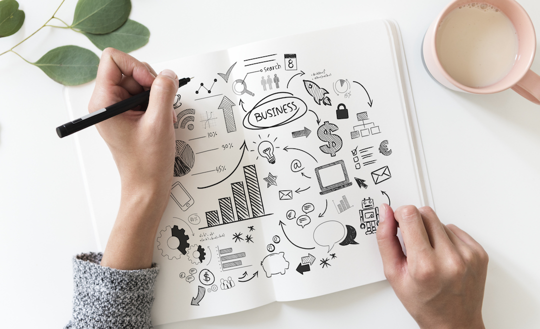 Notebook with cartoon images about business