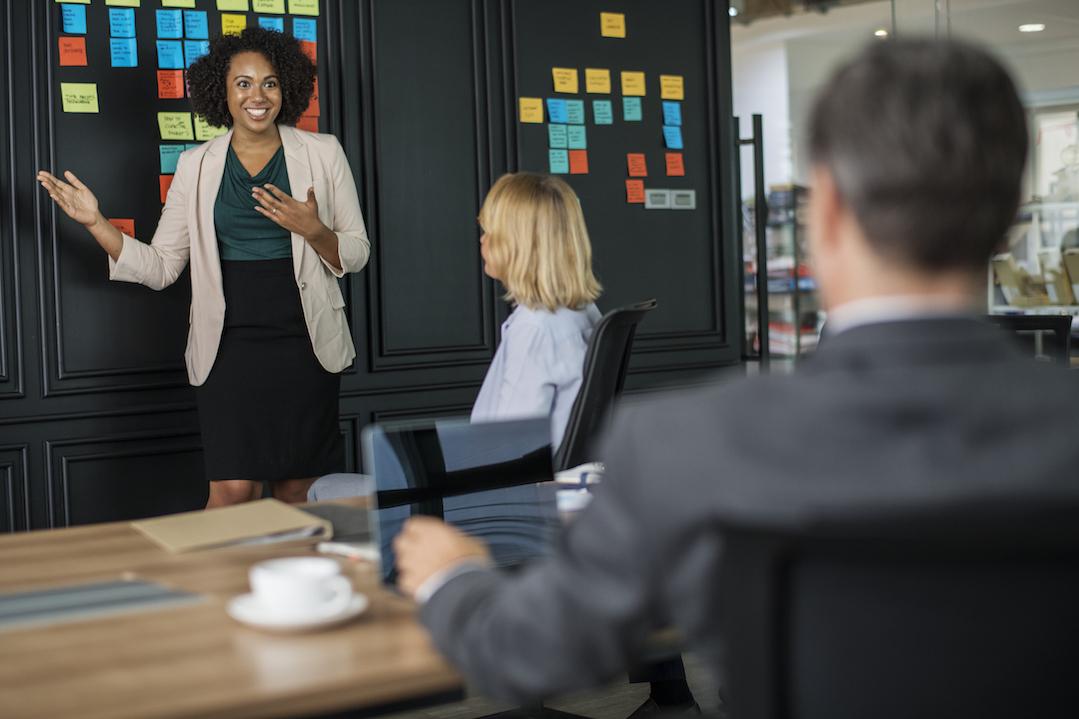 A UX designer gives a presentation to her team