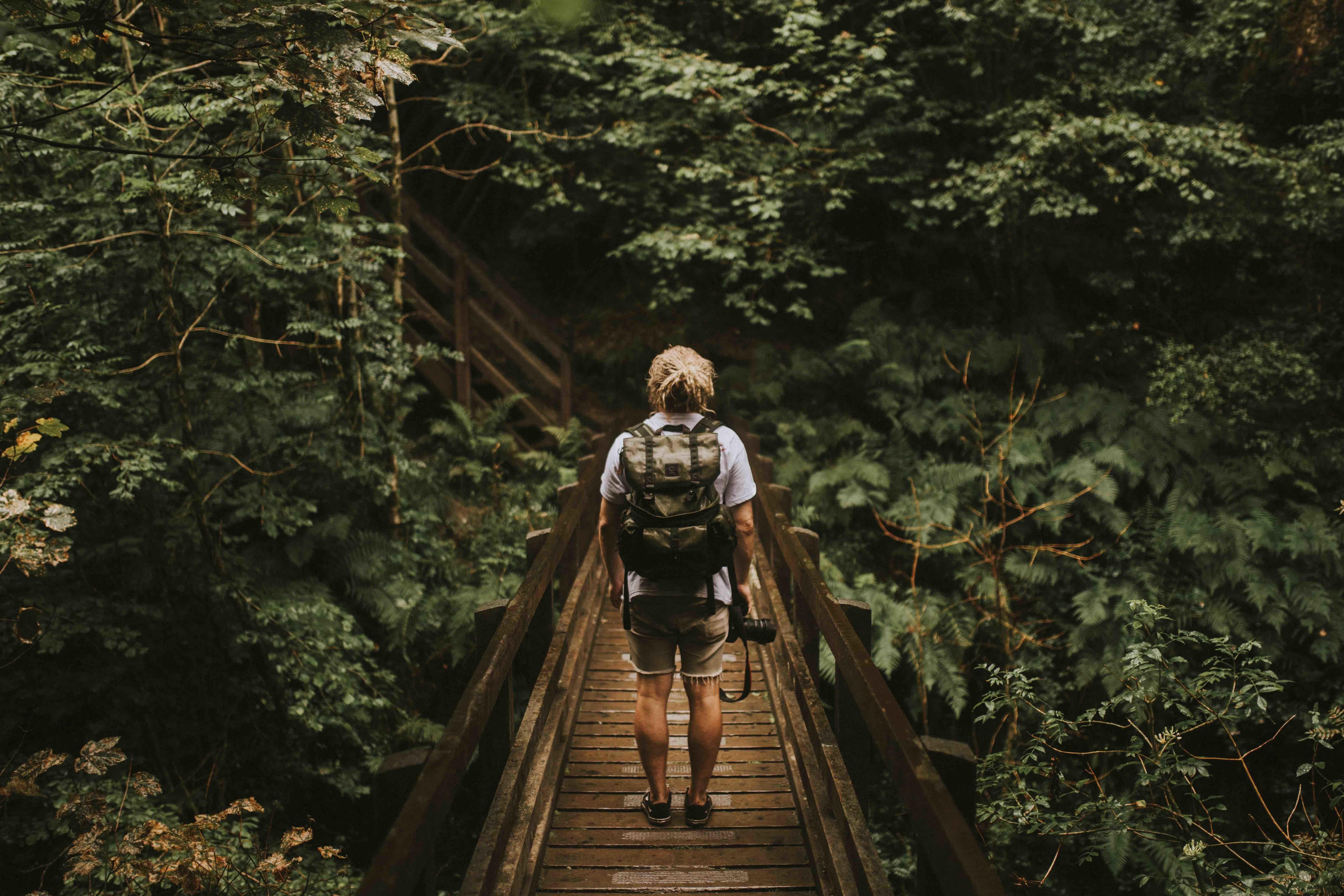 hiker on bridge