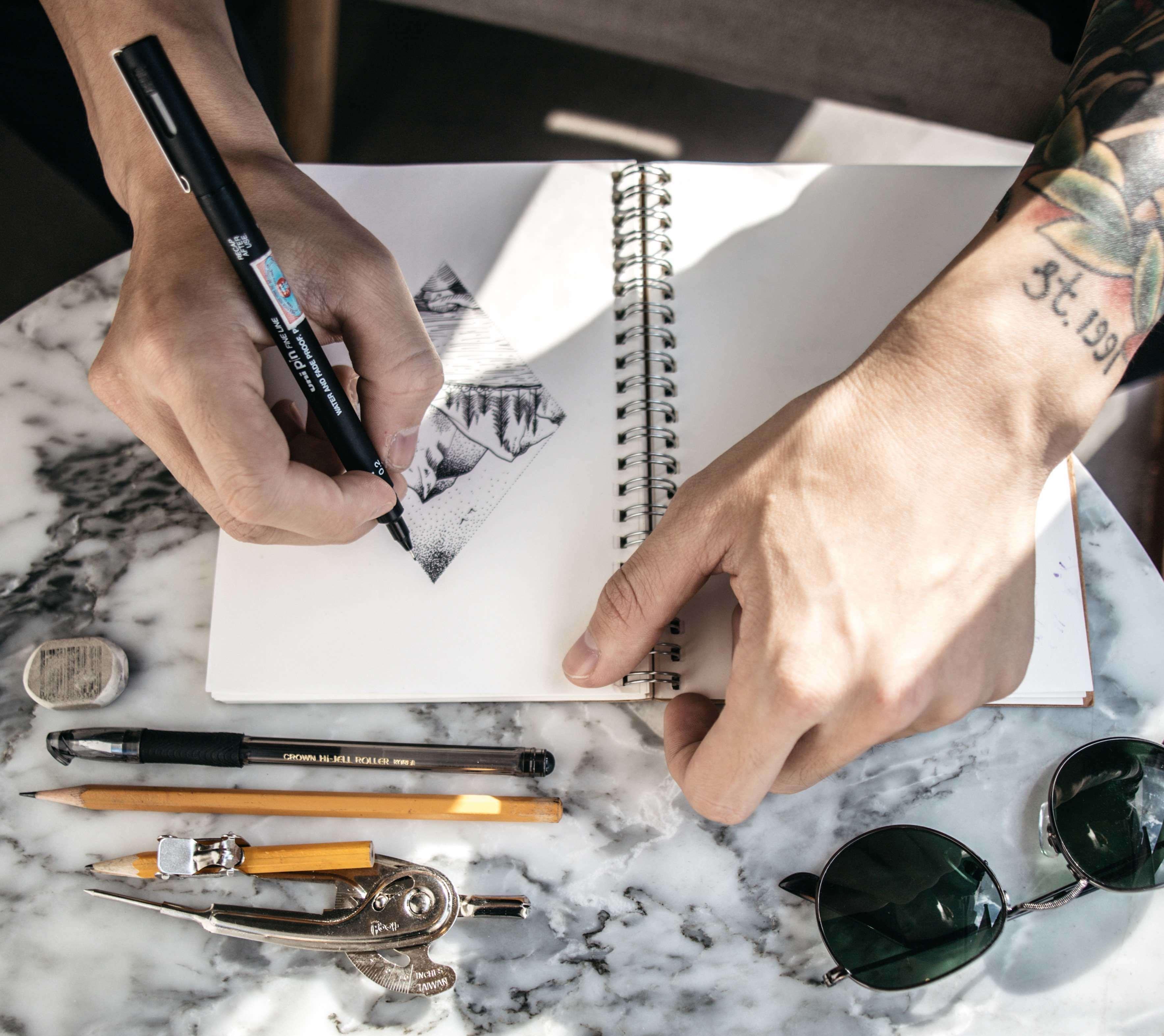 man sketching