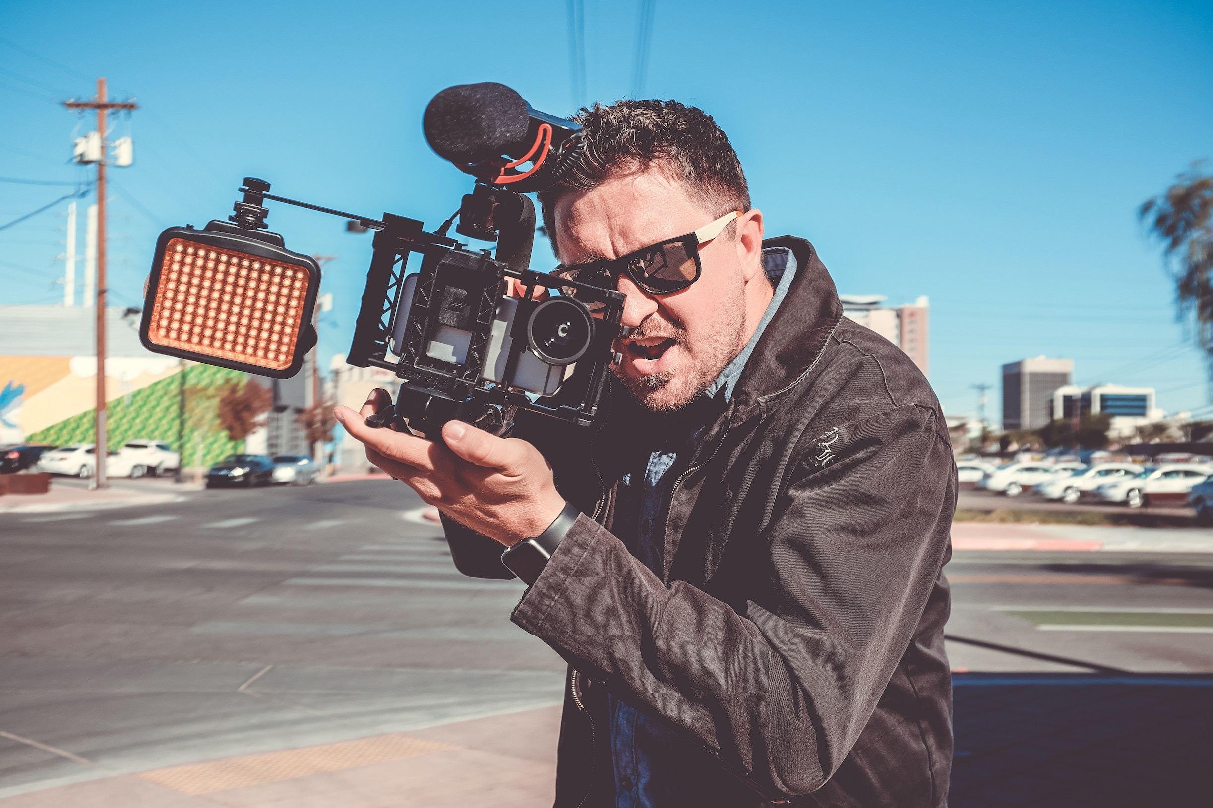 Man with camera looking aggressive