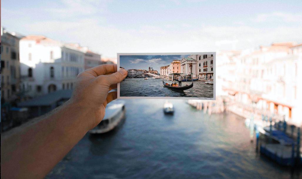 hand holding postcard