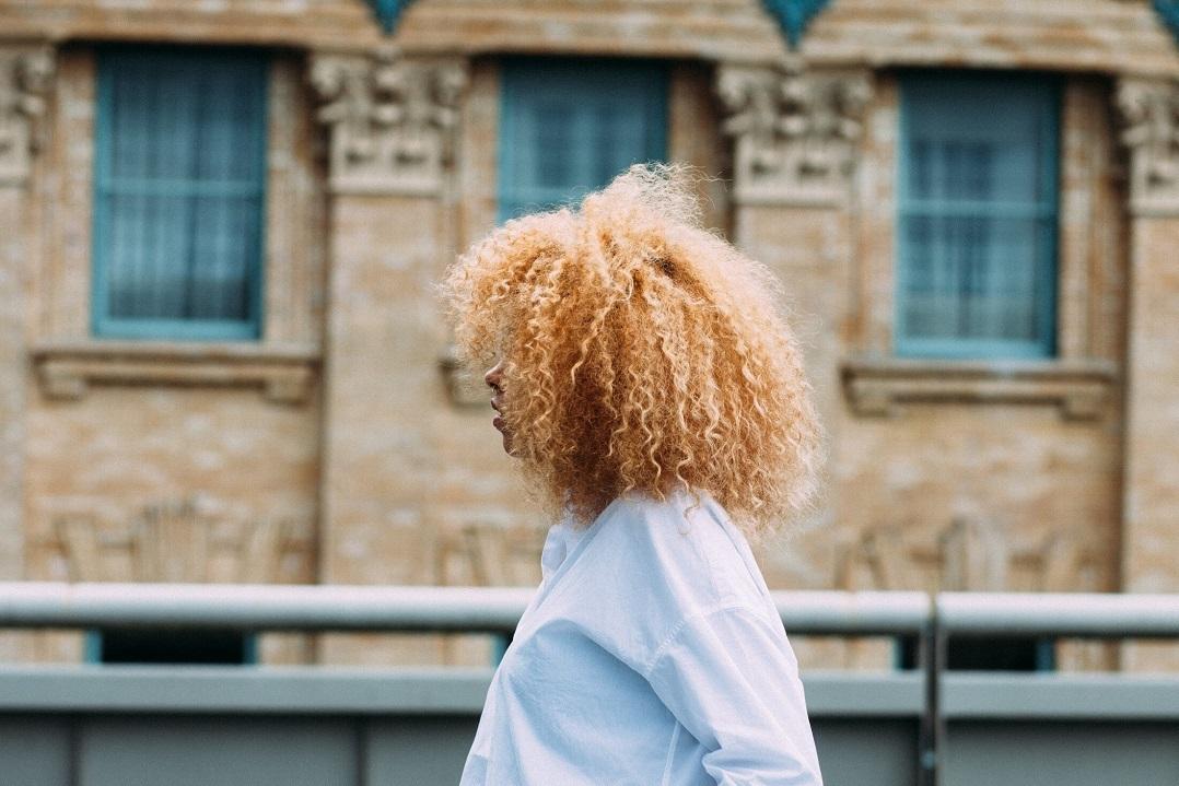 A millennial woman in profile