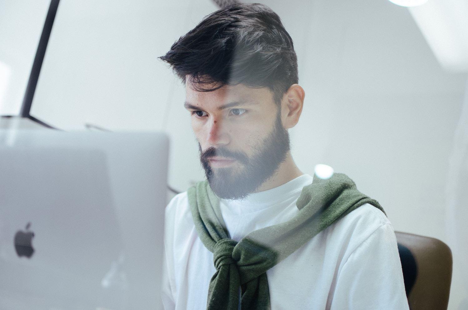 man using computer at work