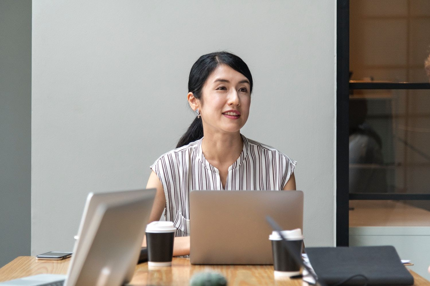 Woman presents at business meeting