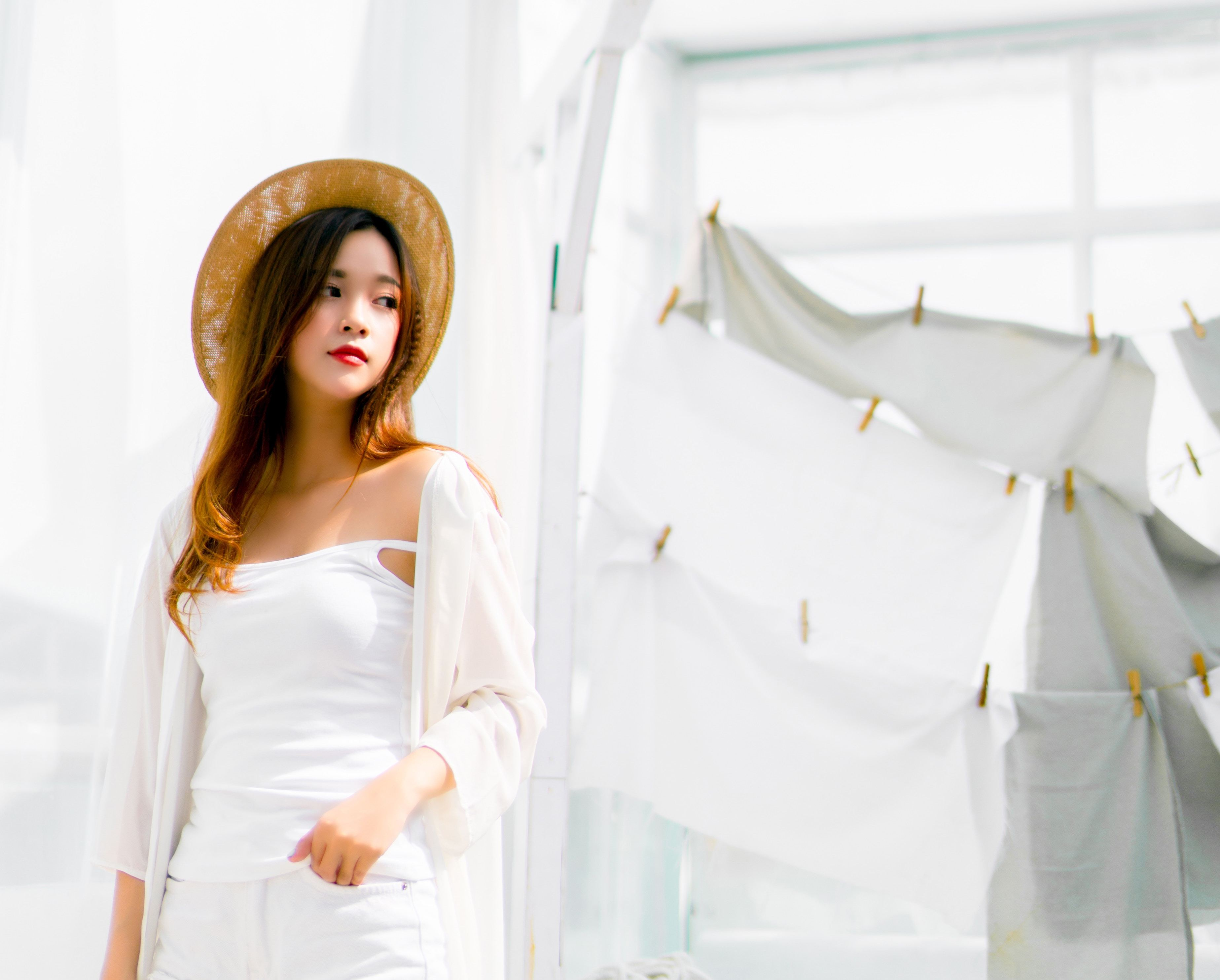 Asian girl dressed in white, on white background