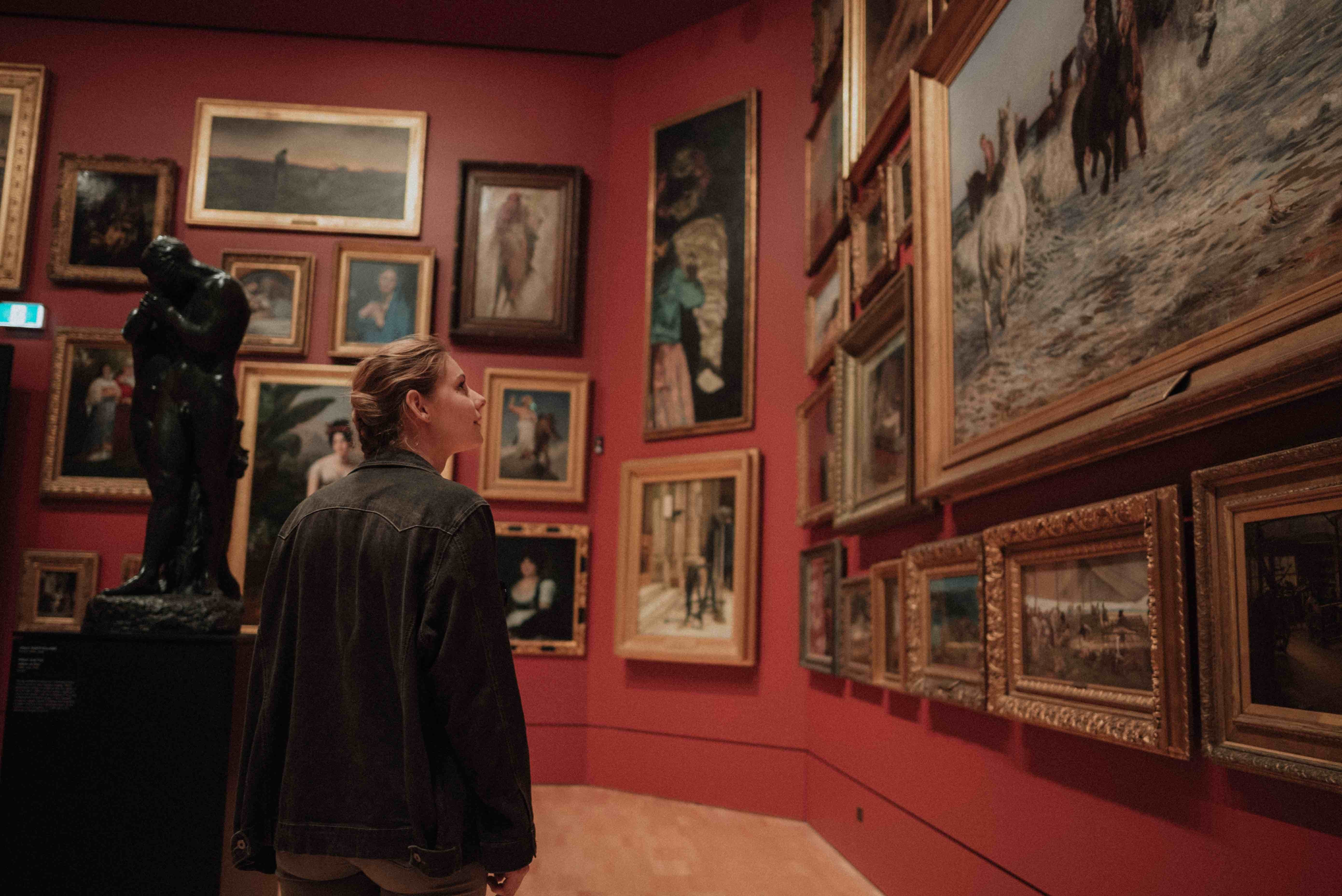 woman looking at pictures in a museum