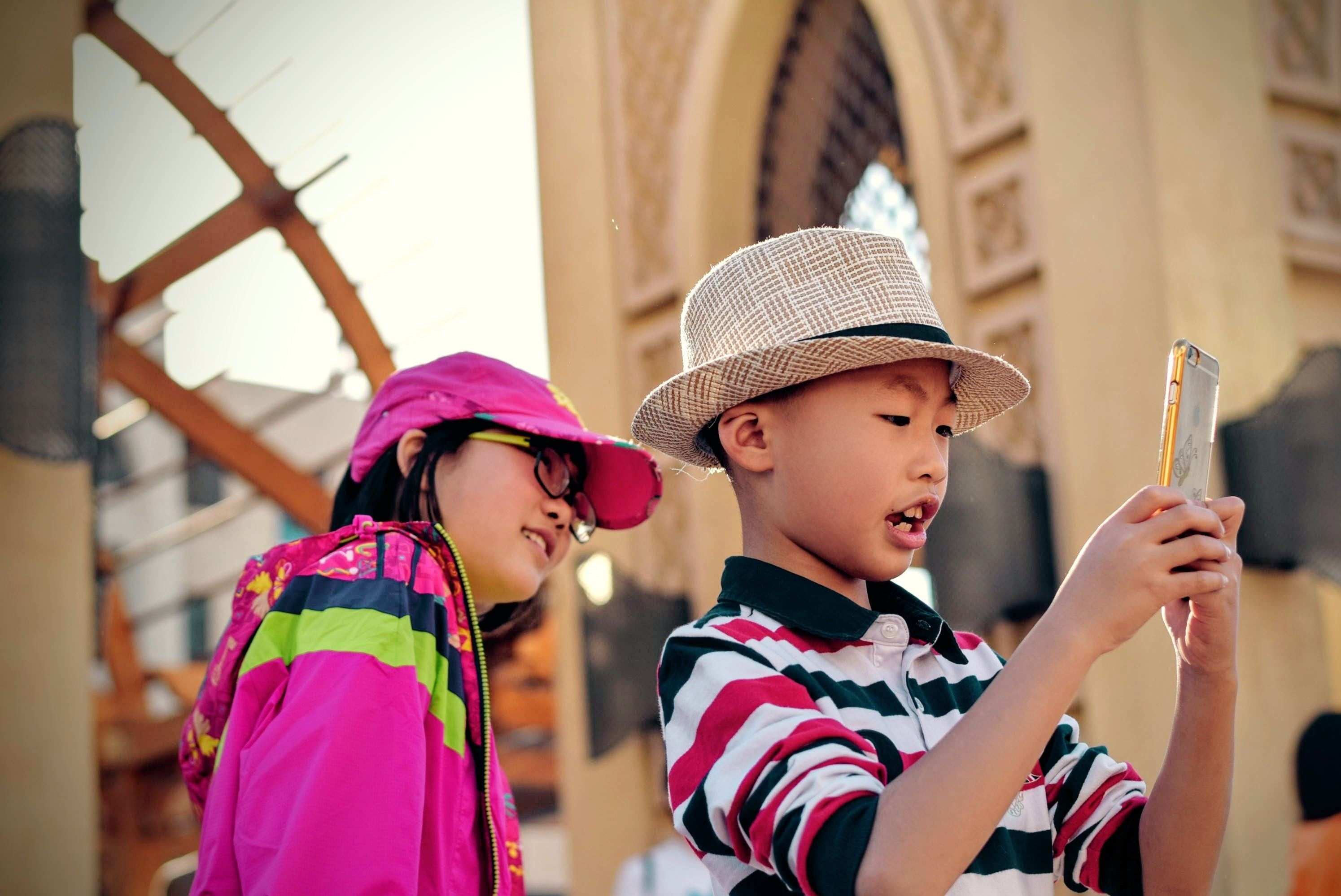 Two Chinese children using a smartphone