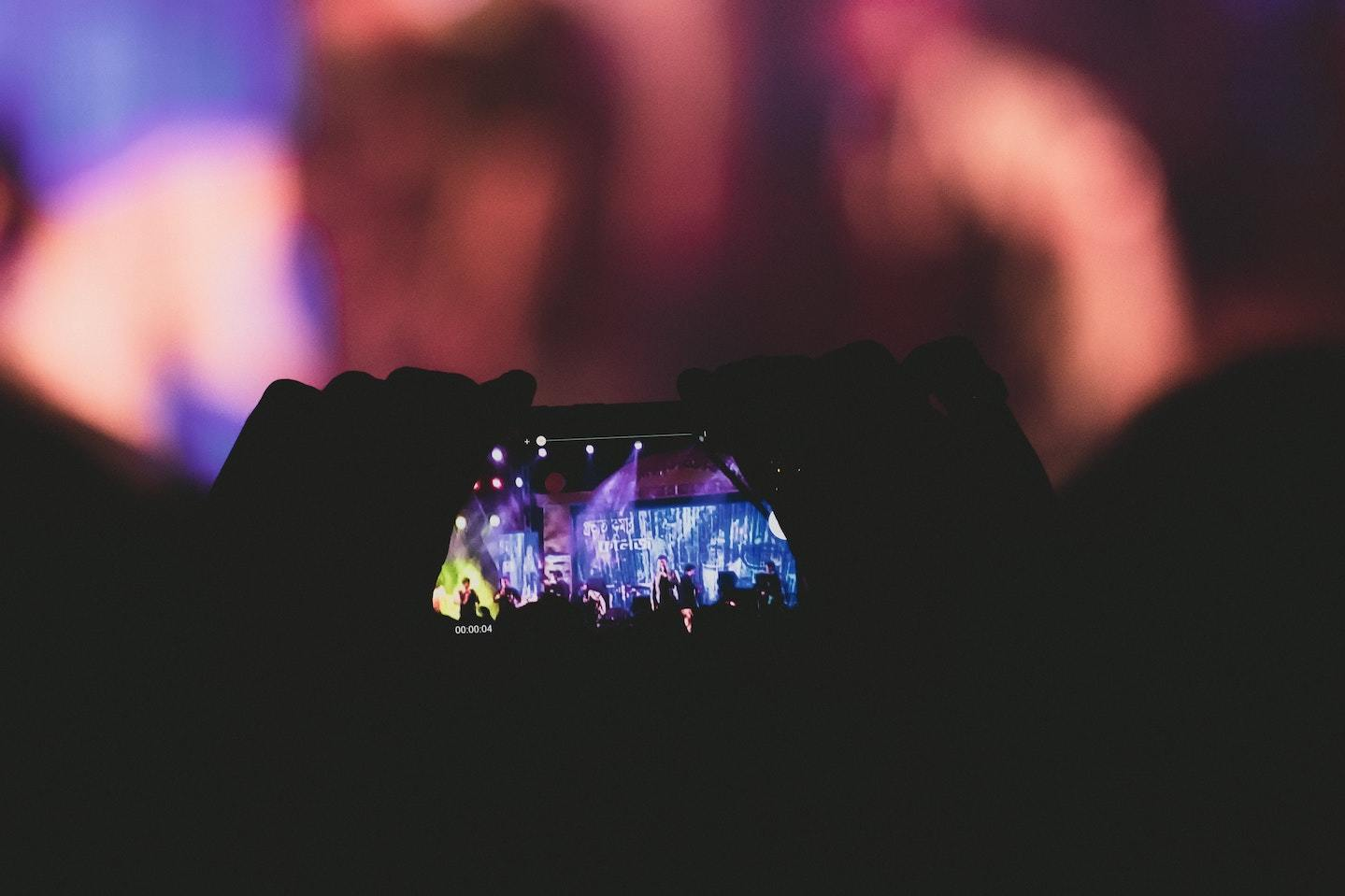 Phone held up to record concert