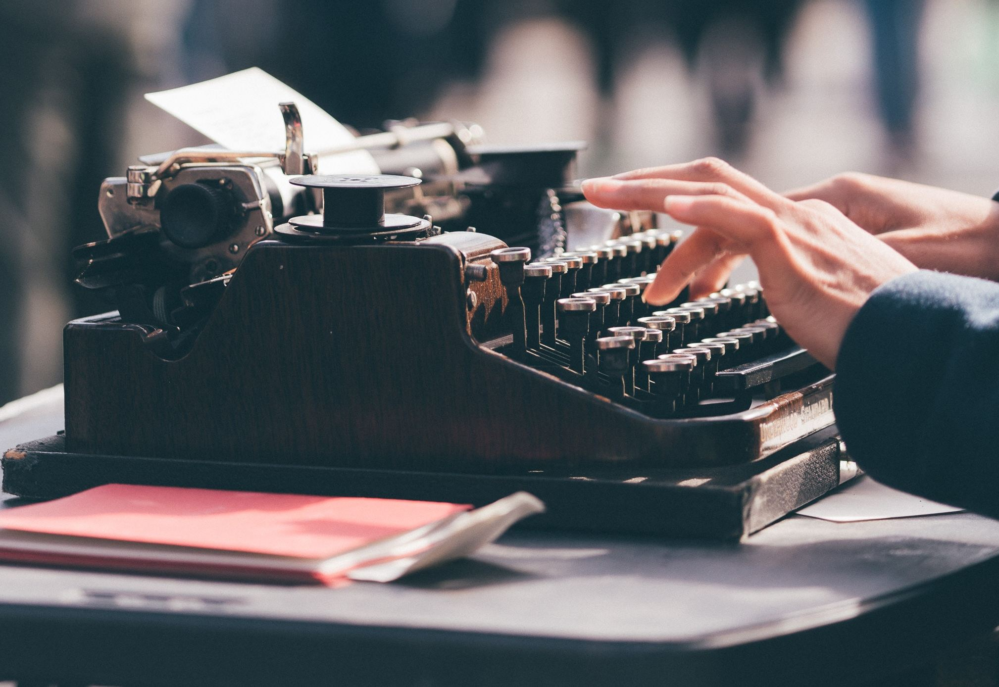 hands typing on typewriter (side view)