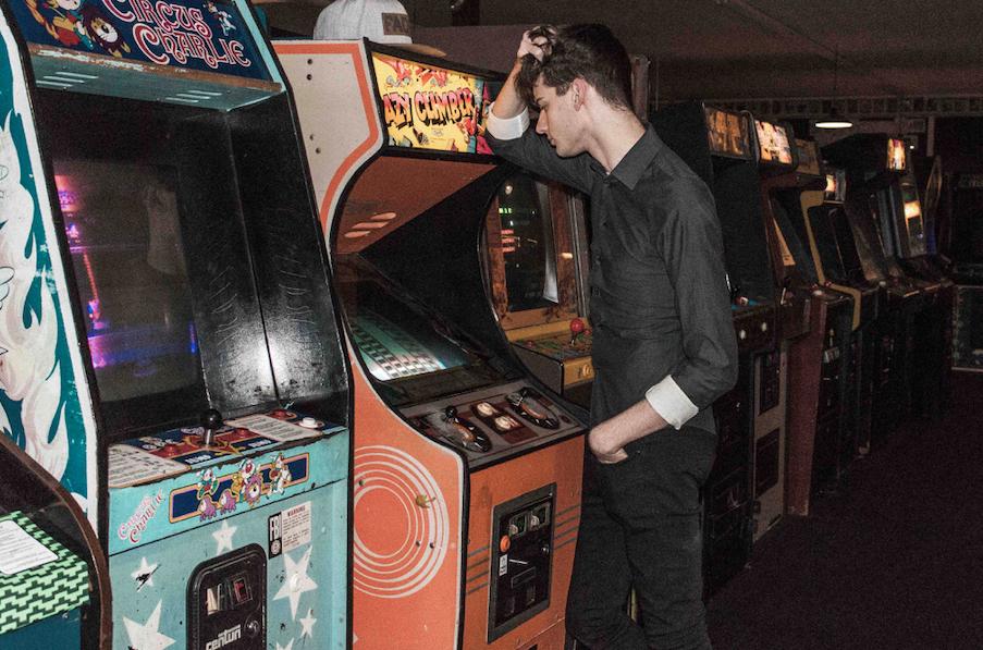 man at arcade