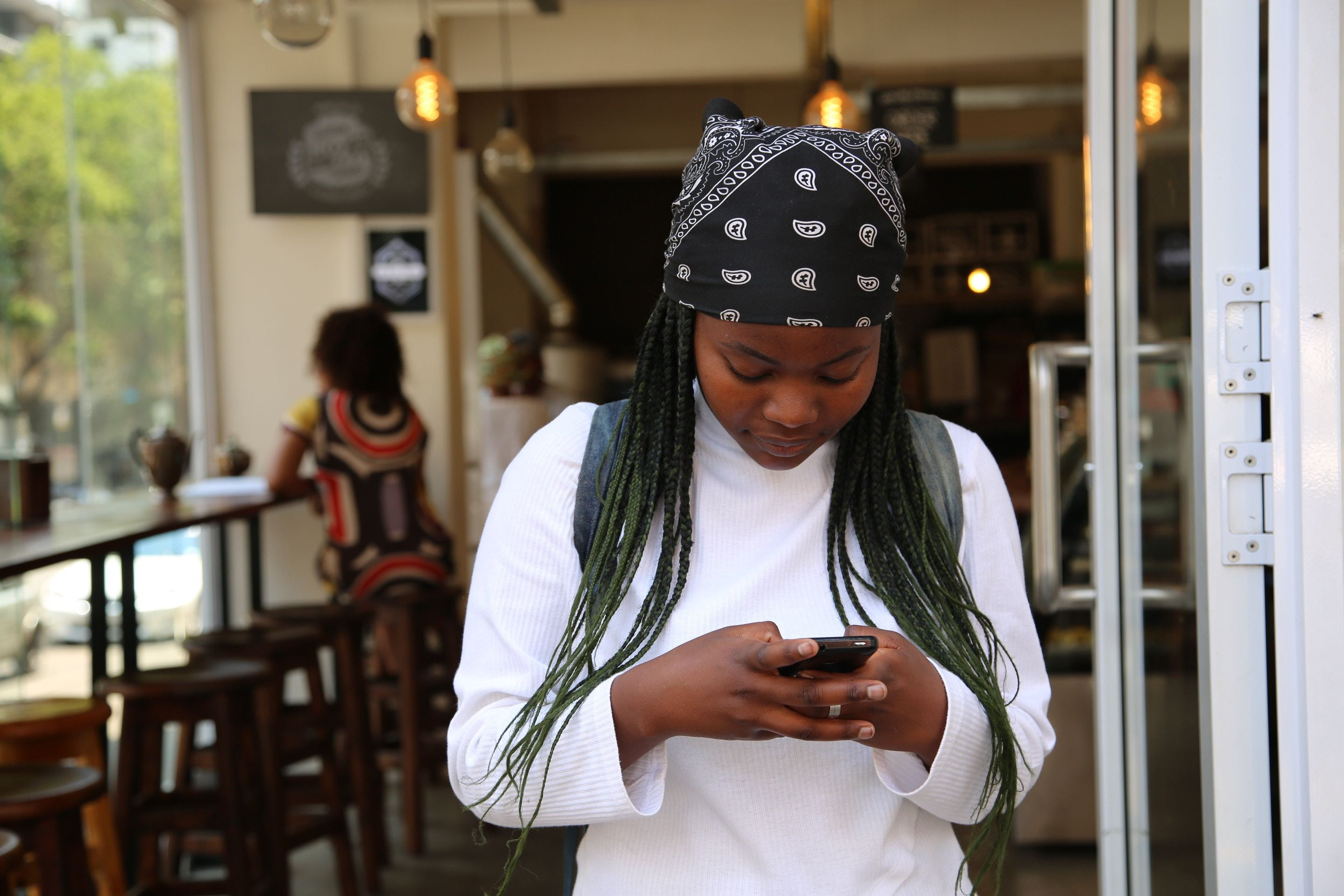 A socially conscious woman receives an action alert from an advocacy organization on her messaging app.