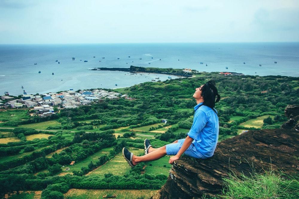 A traveler reaches his destination, enjoying the feeling of success.