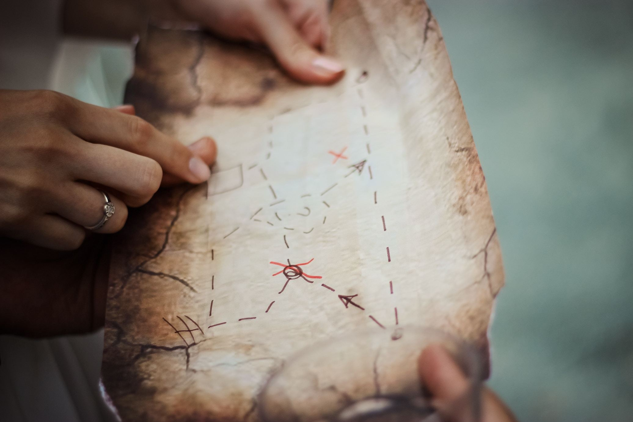 Hands holding a treasure map