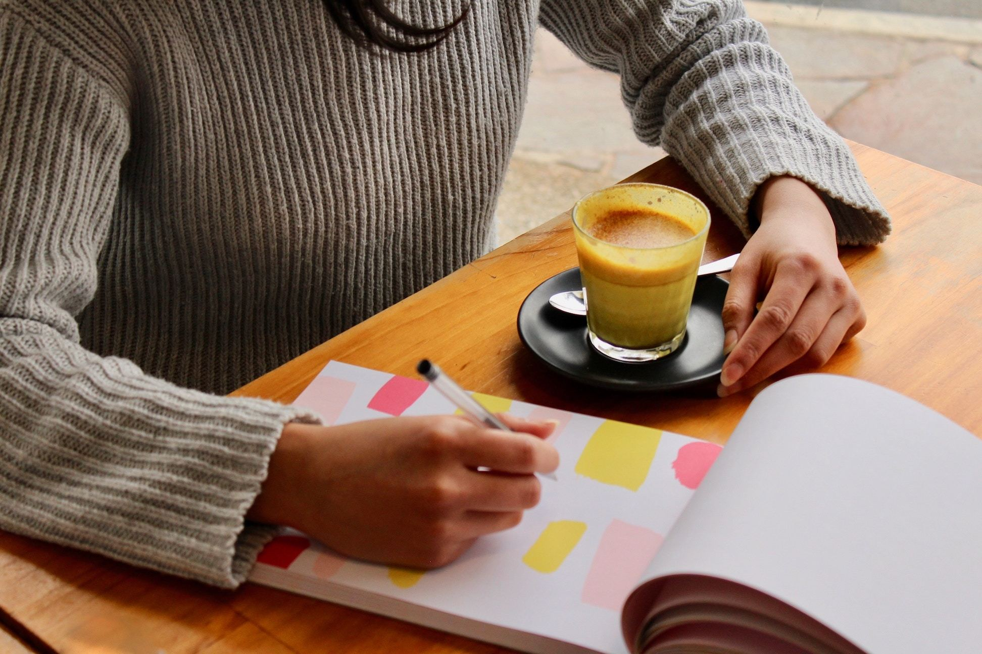 Woman with planning notebook and coffee