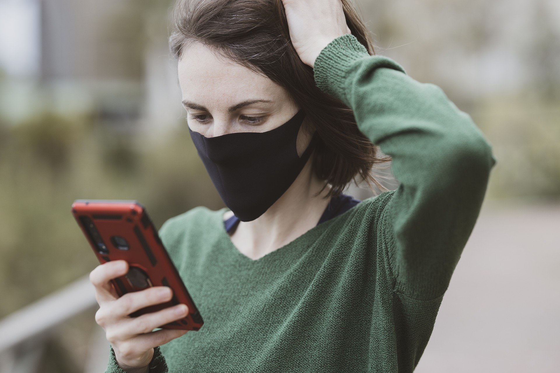 Masked girl with phone