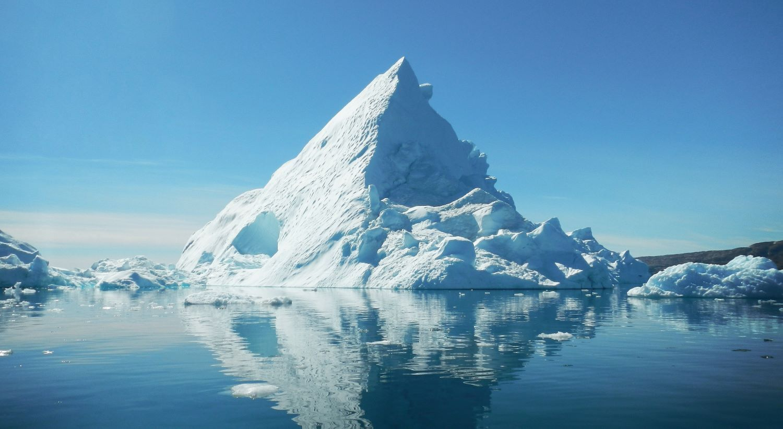 An iceberg in the ocean.