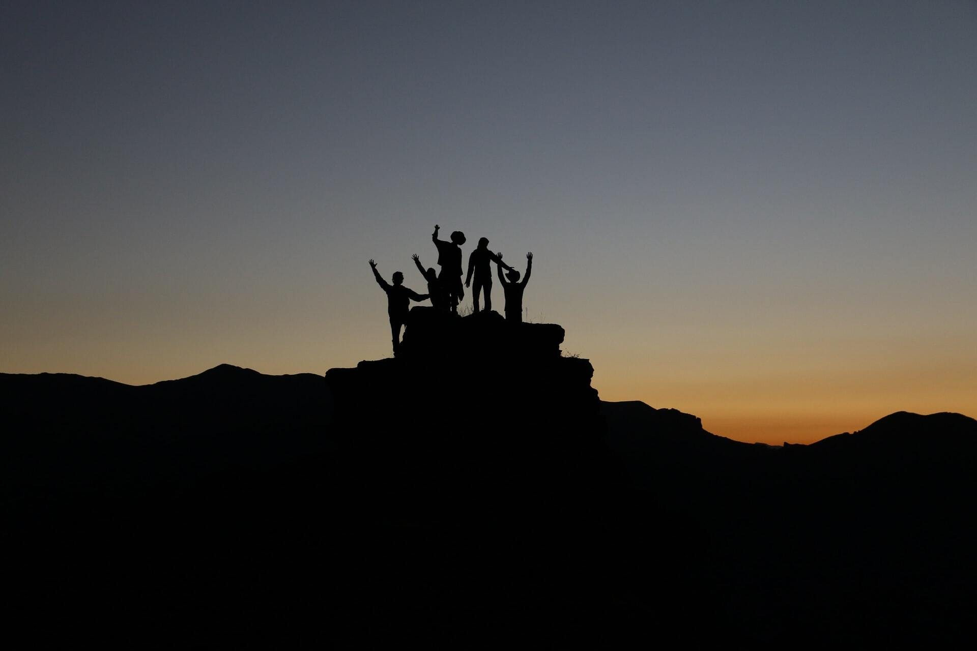 Team reaching the summit together